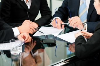 http://www.dreamstime.com/royalty-free-stock-photo-business-meeting-work-contract-image21712995